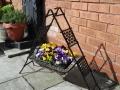 A Buddi garden plant tub stand
